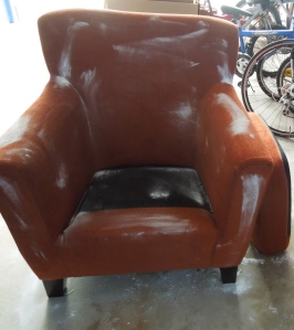 Fabulous but very smelly chair covered with baking soda airing out in my car port.