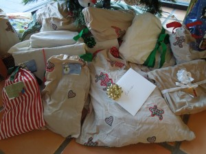 Some presents under the tree, wrapped in re-usable cotton cloth bags, again made for us by my mother.  She is my secret weapon.